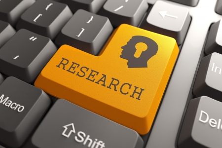 Research and development: Orange Research Button on Computer Keyboard  Searching Concept