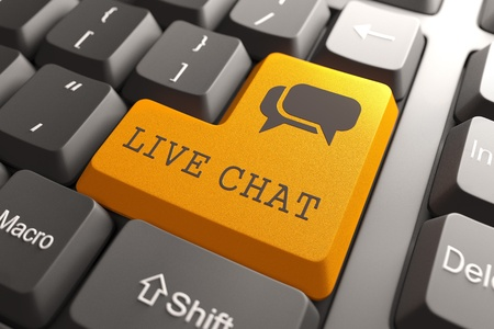 chat: Orange Live Chat Button on Computer Keyboard  Internet Concept  Stock Photo