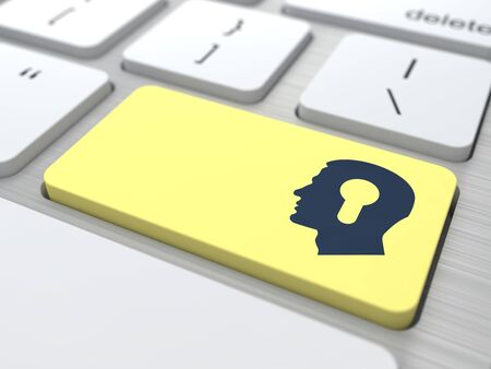 Profile of Head with a Keyhole Located on the Yellow Computer Button  photo