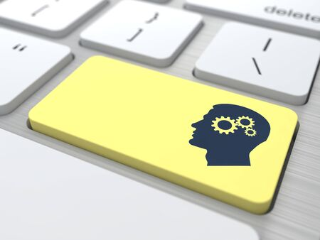 Profile of Head with a Gears on the Yellow Computer Button  photo