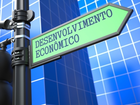 Development Concept  Economic and Development Sign  Portuguese  on Blue Background  photo