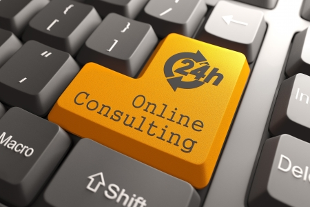 Online Consulting  Orange Button on Computer Keyboard  Internet Concept  photo