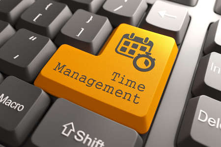 prioritizing:  Time Management  - Orange Button on Computer Keyboard  Business Concept  Stock Photo