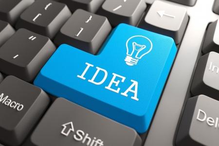 ipotesi: Tasto blu Idea sulla tastiera del Computer Idea Concetto Archivio Fotografico