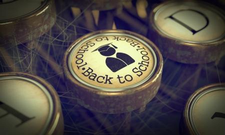 Back to School Button on Old Typewriter  Grunge Background  photo