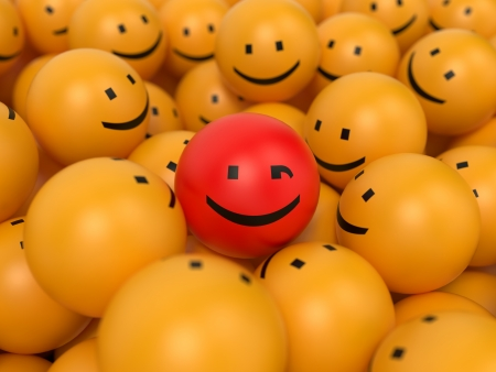 by popularity: Abstract Popularity Concept. Many Yellow Balls with One Red Ball in the Center.