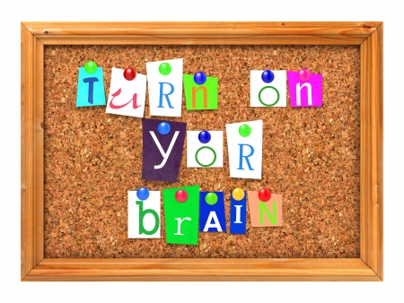 Turn on Your Brain Concept Letters Attached to a Cork Bulletin or Message Board with Thumbtacks. 3D Render. photo