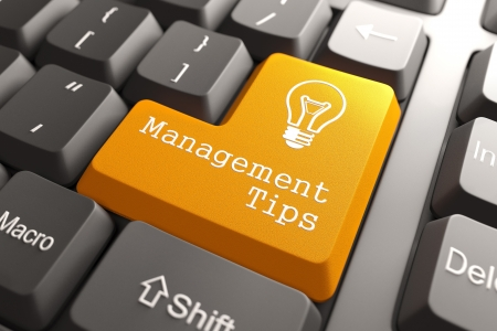 Orange Management Tips Button on Computer Keyboard. Business Concept. photo