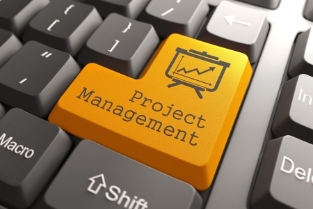 Orange Project Management Button on Computer Keyboard. Business Concept. photo