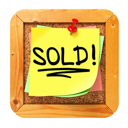 Sold!, Yellow Sticker on Cork Bulletin or Message Board. Business Concept. 3D Render. photo