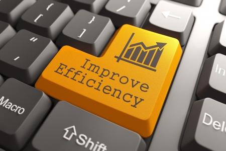 Oranje efficiëntie te verbeteren knop op toetsenbord van de computer. Business Concept.