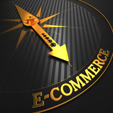 E-Commerce - Business Background. Golden Compass Needle on a Black Field Pointing to the Word 'E-Commerce'. 3D Render. photo