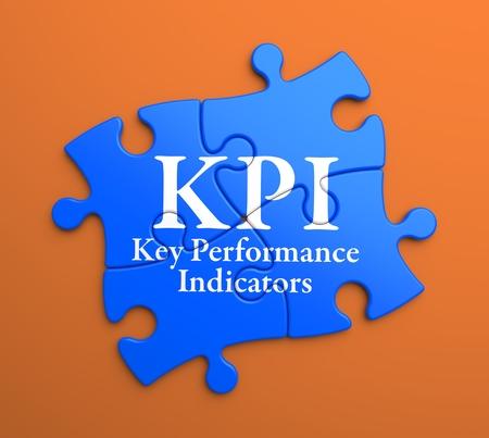 assessment system: KPI - Key Performance Indicators - Written on Blue Puzzle Pieces on Orange Background. Business Concept.