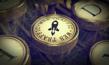 Web Traffic Button on Old Typewriter. Internet Concept. Grunge Background for Your Publications. photo