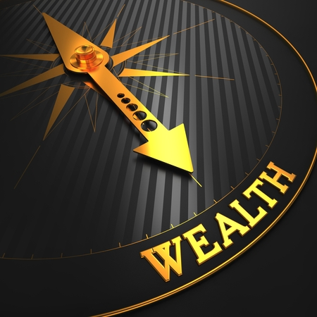 Wealth - Business Background. Golden Compass Needle on a Black Field Pointing to the Word