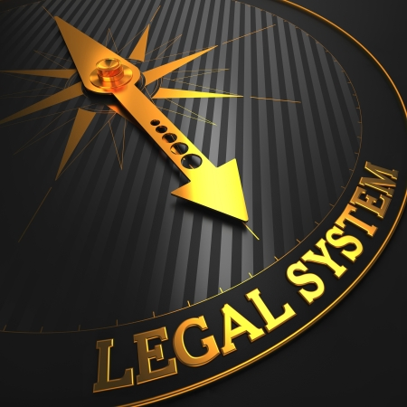 paralegal: Legal System - Business Background. Golden Compass Needle on a Black Field Pointing to the Word Legal System. 3D Render.