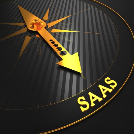 SAAS - Information Technology Concept  Golden Compass Needle on a Black Field Pointing to the Word  SAAS   3D Render  photo