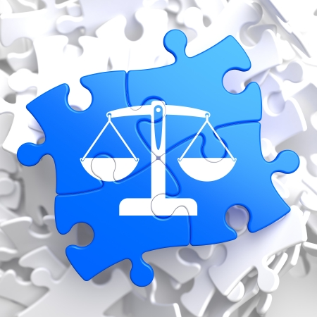 the litigation: Justice Concept - Icon of Scales in Balance- Located on Blue Puzzle Pieces.