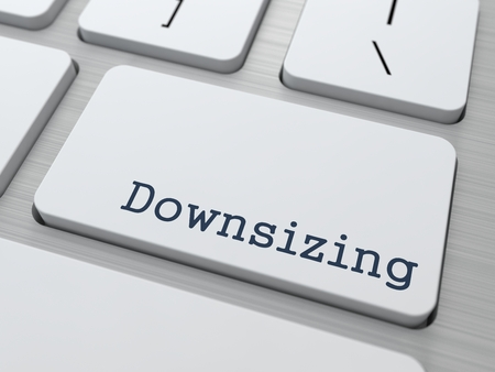 Downsizing. Button on Modern Computer Keyboard. Business Concept. 3D Render.