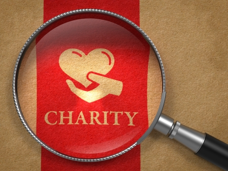charity person: Charity Concept: Magnifying Glass with Icon of Heart in the Hand and Word Charity on Old Paper with Red Vertical Line Background.