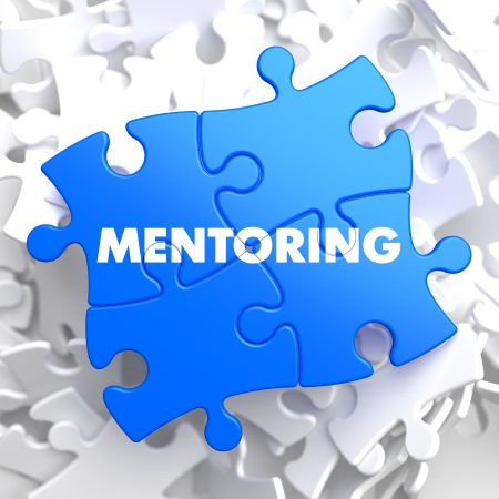 Mentoring Writing on Blue Puzzle Pieces. Business Educational Concept.