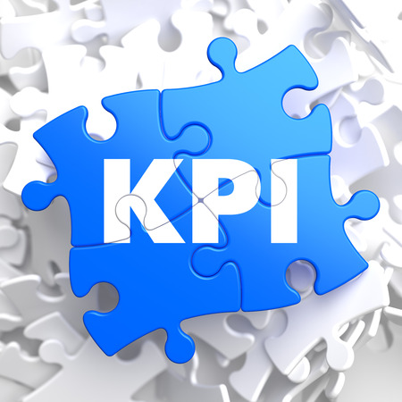 quality: KPI - Key Performance Indicators - Written on Blue Puzzle Pieces. Business Concept.