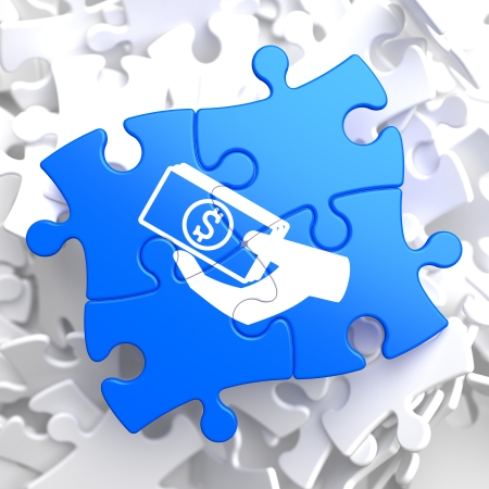 Donate Concept - Icon of Money in the Hand - Located on Blue Puzzle Pieces  Social Background  Stock Photo