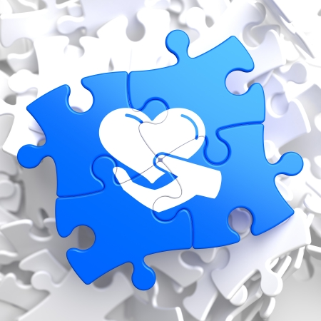 selfless: Charity Concept - Icon of Heart in the Hand - Located on Blue Puzzle Pieces. Social Background.