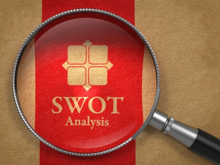 SWOT Analysis Concept: Magnifying Glass with Icon and Words SWOT Analysis on Old Paper with Red Vertical Line Background. photo