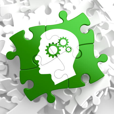 brain mysteries: Psychological Concept - Profile of Head with Cogwheel Gear Mechanism Located on Green Puzzle Pieces