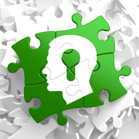 Psychological Concept - Profile of Head with a Keyhole Located on Green Puzzle Pieces  photo
