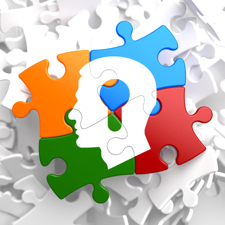Psychological Concept - Profile of Head with a Keyhole Located on Multicolor Puzzle. photo
