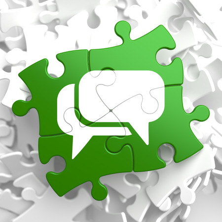 White Speech Bubble Icon on Green Puzzle. Communication Concept. Stock Photo - 23101560