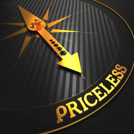 priceless: Priceless - Business Background. Golden Compass Needle on a Black Field Pointing to the Word Priceless. 3D Render.