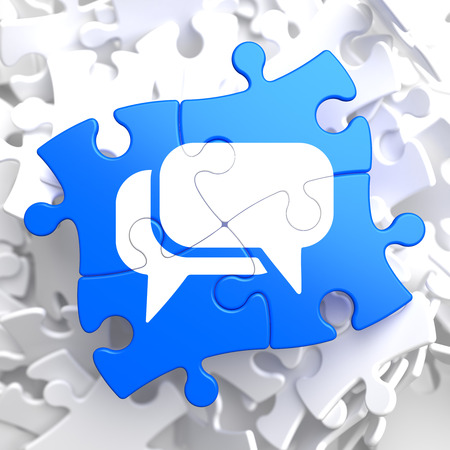 White Speech Bubble Icon on Blue Puzzle. Communication Concept. photo