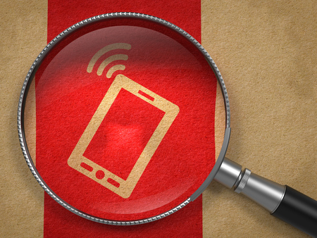 Magnifying Glass with Smartphone Icon on Old Paper with Red Vertical Line Background. Mobile Technology Concept. photo