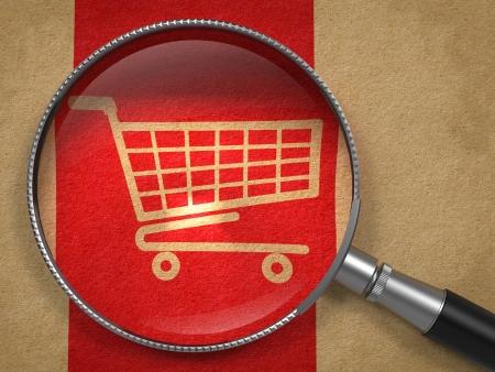 icon shopping cart: Lupe mit Einkaufswagen-Symbol auf altem Papier mit Red Vertical Line Hintergrund. Business-Konzept.