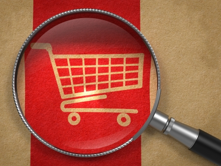 supermarket cart: Magnifying Glass with Shopping Cart Icon on Old Paper with Red Vertical Line Background. Business Concept.