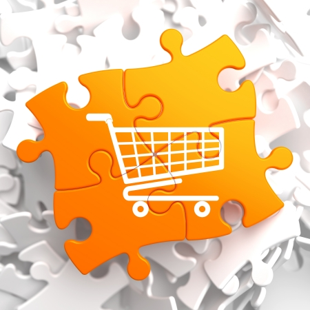 ebusiness: Icon of Shopping Cart on Orange Puzzle. Stock Photo