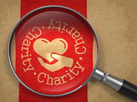 fundraiser: Magnifying Glass with Charity Word Written Arround Icon of Heart in the Hand on Old Paper with Red Vertical Line Background. Social Concept.