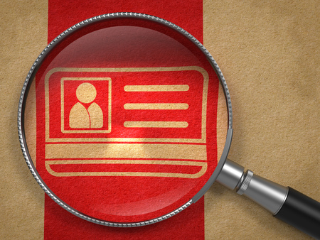 Magnifying Glass with ID Card Icon on Old Paper with Red Vertical Line Background. Identification Concept. photo