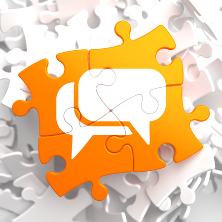 White Speech Bubble Icon on Orange Puzzle. Communication Concept. Stock Photo - 23512951