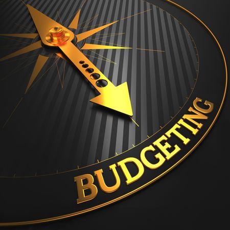 taxes budgeting: Budgeting - Business Concept. Golden Compass Needle on a Black Field Pointing to the Budgeting Word. Stock Photo