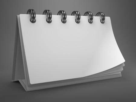 White Blank Desktop Calendar on Gray Background. photo