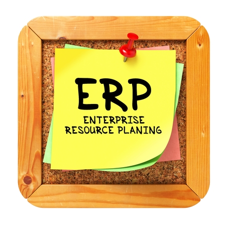 erp: ERP -  Enterprise Resource Planning - Written on Yellow Sticker on Cork Bulletin or Message Board. Business Concept.