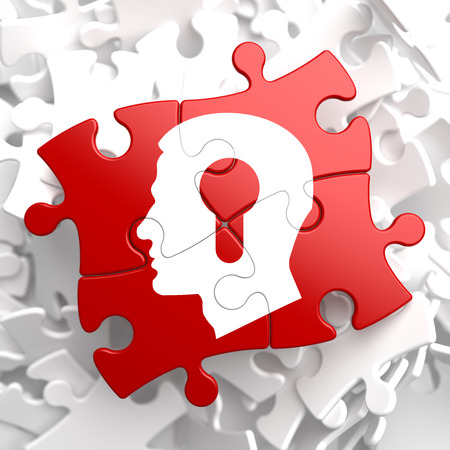 Psychological Concept - Profile of Head with a Keyhole Located on Red Puzzle. photo