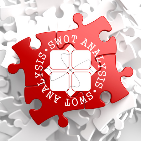 SWOT Analisis Written Arround Icon on Red Puzzle. Business Concept. photo
