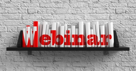 Webinar - Red Inscription on the Books on Shelf on the White Brick Wall Background. Education Concept. photo