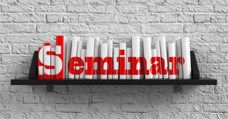 Seminar - Red Inscription on the Books on Shelf on the White Brick Wall Background. Education Concept.