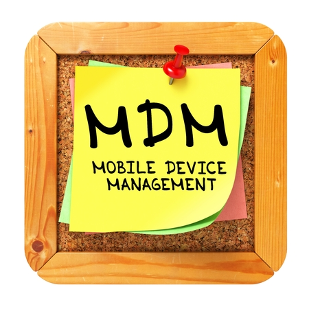 MDM - Mobile Device Management - Written on Yellow Sticker on Cork Bulletin or Message Board. photo